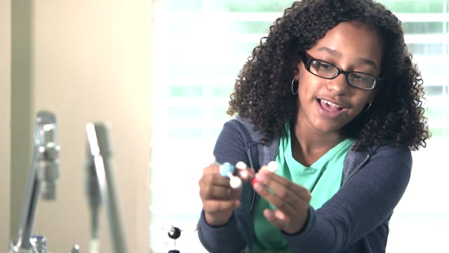 mixed race girl in science class with molecules - schoolgirl stock videos and b-roll footage