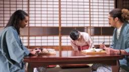 Mixed Race Guests and Japanese Server at Tokyo Ryokan