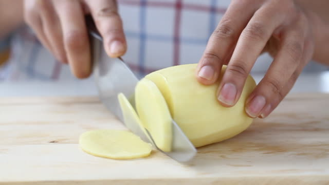 mixed race hands chopping a potato - raw potato stock videos & royalty-free footage