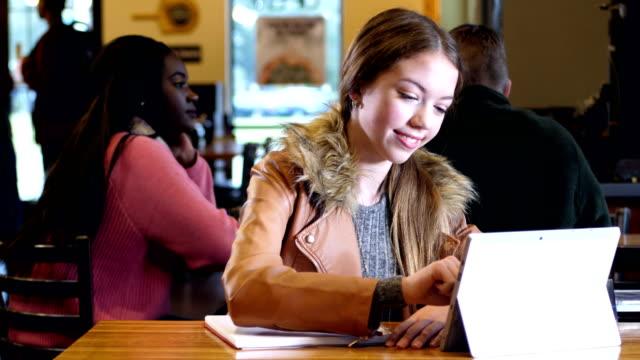 Mixed race Hispanic teenage girl studying