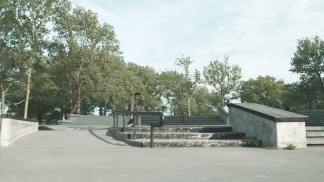 A mixed race man skateboarding at a park in Queens, NYC - 4k - slow motion