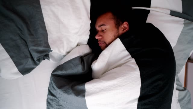 mixed race man suffering from insomnia - roll over stock videos and b-roll footage