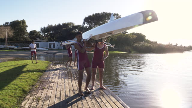 vidéos et rushes de mixed race rowing team preparing to go training - équipage de bateau