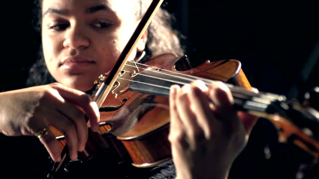 mixed race teenage girl playing violin - string instrument stock videos and b-roll footage