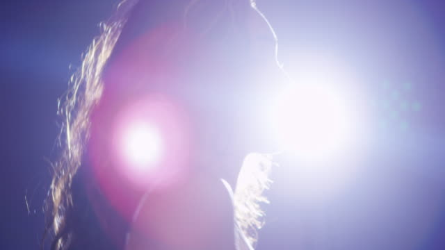 stockvideo's en b-roll-footage met mixed race woman dancing in front of studio light - gympak