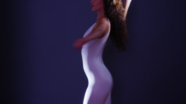 vídeos de stock e filmes b-roll de mixed race woman dancing in white unitard - body de ginástica