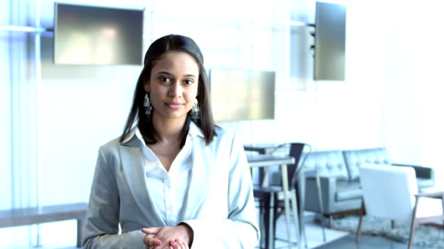 Mixed race young businesswoman in business lounge