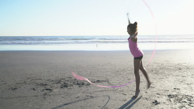 ws mixed raced girl dancing on the beach at sunset - ballet dancing stock videos & royalty-free footage