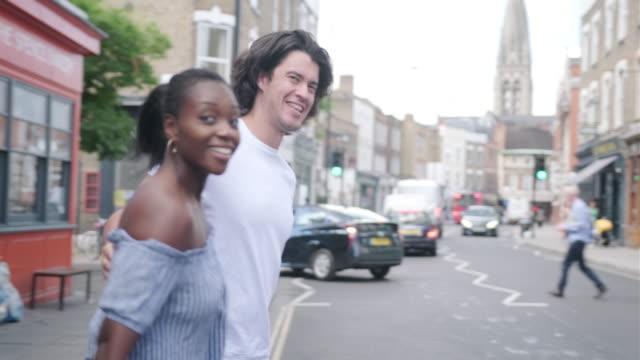 mixed raced heterosexual couple walking around london - hackney stock videos & royalty-free footage