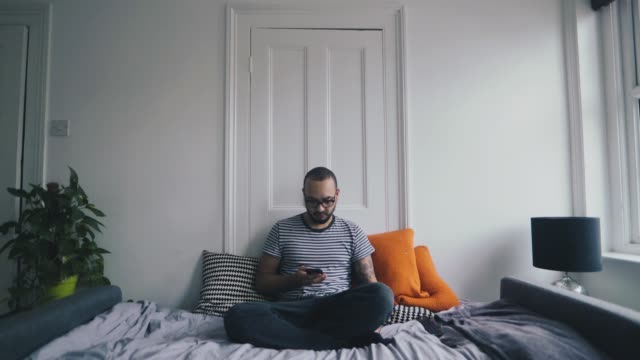 Mixed raced man sitting on sofa