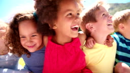 Mixed racial group of friendly children laughing together