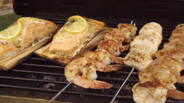 mixed seafood grill with salmon, scallops and jumbo shrimp - invertebrate stock videos & royalty-free footage