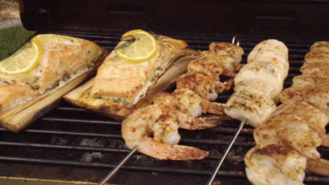 mixed seafood grill with salmon, scallops and jumbo shrimp - ketogenic diet stock videos & royalty-free footage