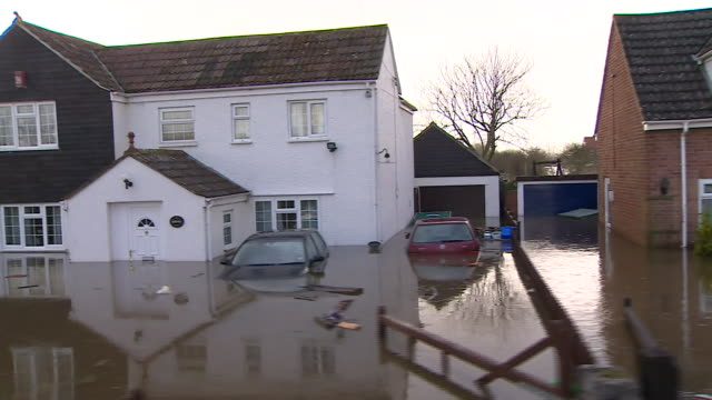 Mixed shots of flooding on residential streets of Moorland Somerset