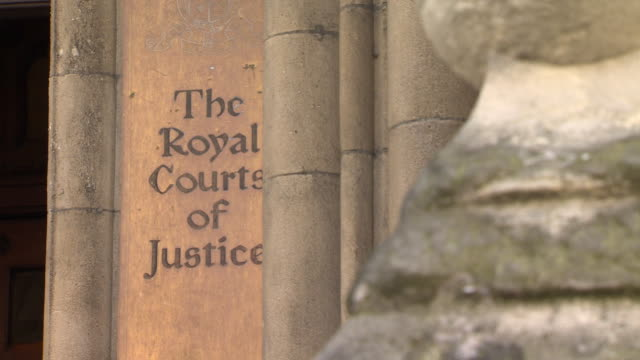 mixed shots of the royal courts of justice signs and building - law stock videos & royalty-free footage