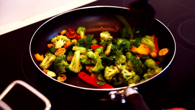 Mixed vegetables being stir-fried in a pan