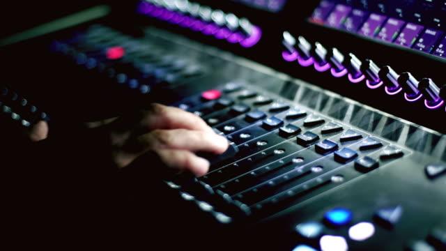 dj mixer console at nightclub party. - audio disponibile sulla versione digitale video stock e b–roll