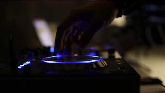dj mixer under glowing lights - hip hop stock videos & royalty-free footage