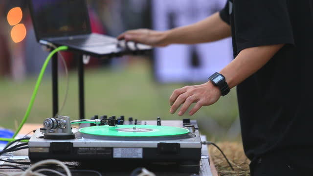 dj mixes and scratches in concert - knob stock videos and b-roll footage