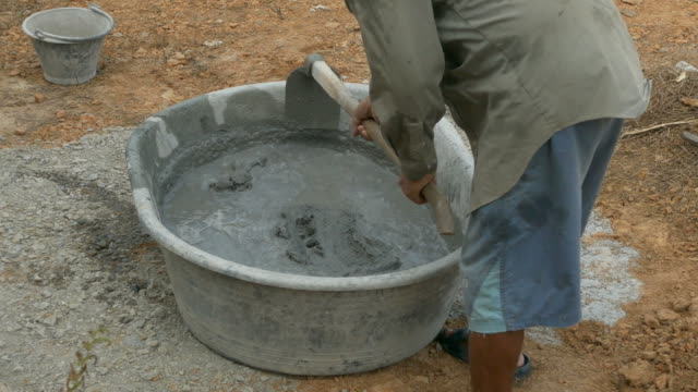 mixing a cement in salver - mixing stock videos & royalty-free footage