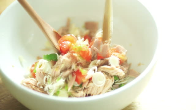 mixing a spicy tuna salad in the bowl - salad bowl stock videos & royalty-free footage