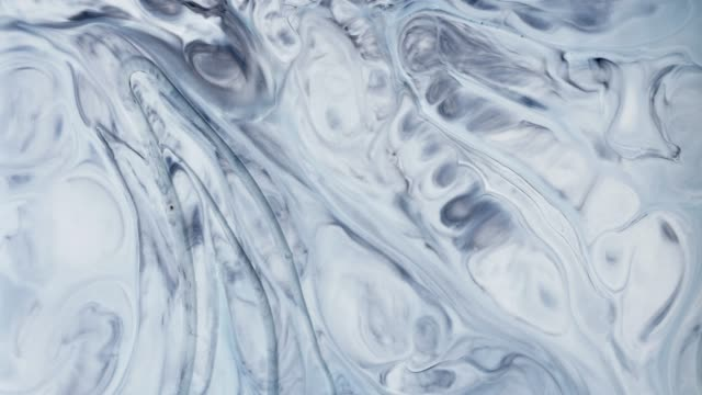 mixing acrylic paints in liquid. macro. - marbled effect stock videos & royalty-free footage