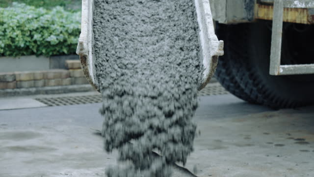 mixing cement from cement truck at the construction site. - concrete stock videos & royalty-free footage