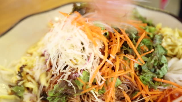 mixing chuncheon-style buckwheat noodles with garnish by hand - garnish stock videos & royalty-free footage