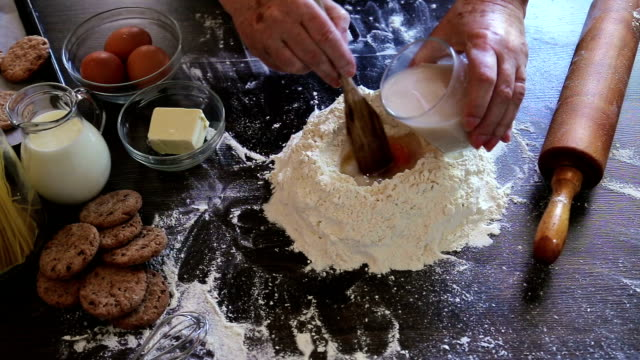 mixing dough - stereotypical housewife stock videos & royalty-free footage