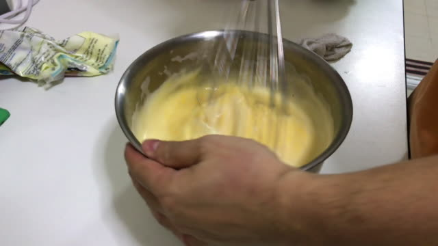mixing eggs and sugar with a whisk for cake dough - whipped food stock videos and b-roll footage
