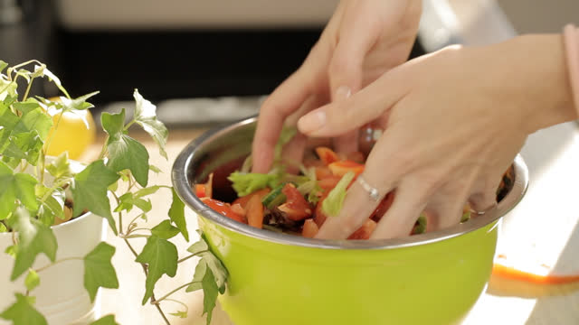 mixing freshly made salad in a bowl with hands - chopped lettuce stock videos & royalty-free footage