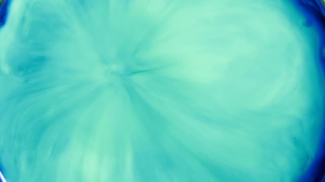 mixing liquids. blue and green vibrant colors - dissolving stock videos & royalty-free footage