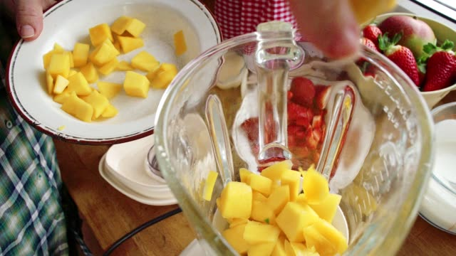 mixing mango in a blender for preparing ice cream on stick - popsicle stick stock videos and b-roll footage