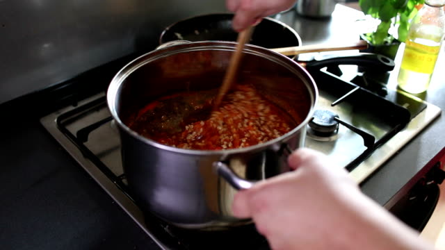mixing meat with tomato sauce for spaghetti bolognese - spaghetti bolognese stock videos & royalty-free footage