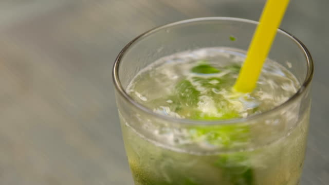 mixing mojito cocktail with straw - crushed ice stock videos & royalty-free footage