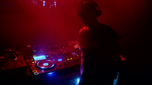 dj mixing music at club - entertainment club stock videos & royalty-free footage