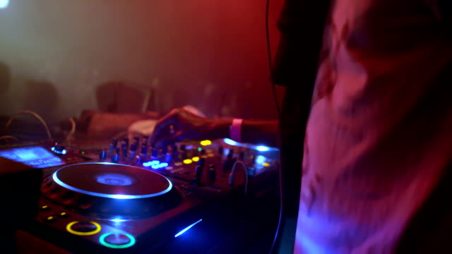 dj mixing music at club - record player stock videos & royalty-free footage