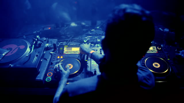 dj mixing music at club - techno music stock videos & royalty-free footage