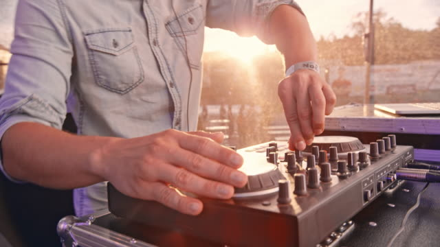 dj mixing music in sunshine - knob stock videos & royalty-free footage