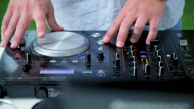 dj mixing outdoors - record player stock videos & royalty-free footage