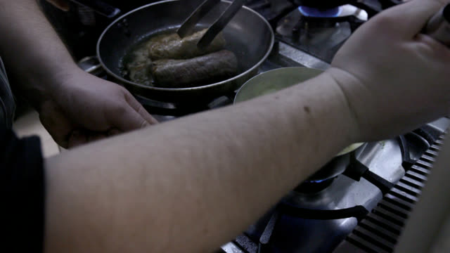 mixing puree in saucepan with a wire whisk on the stove - wire whisk stock videos and b-roll footage