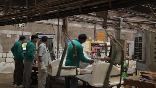 mixing various components - clay,quartz - to make slurry at hindustan sanitaryware ltd. in bahadurgarh, haryana, india on monday, june 11, 2018. - quartz stock videos & royalty-free footage