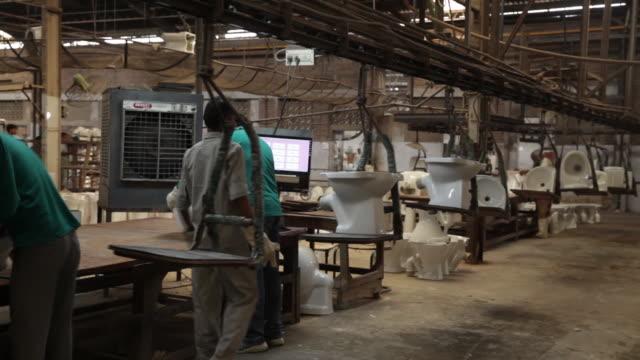 mixing various components clayquartz to make slurry at hindustan sanitaryware ltd in bahadurgarh haryana india on monday june 11 2018 - haryana stock videos & royalty-free footage