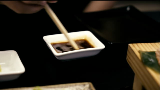 mixing wasabi in soy sauce. - wasabi stock videos and b-roll footage