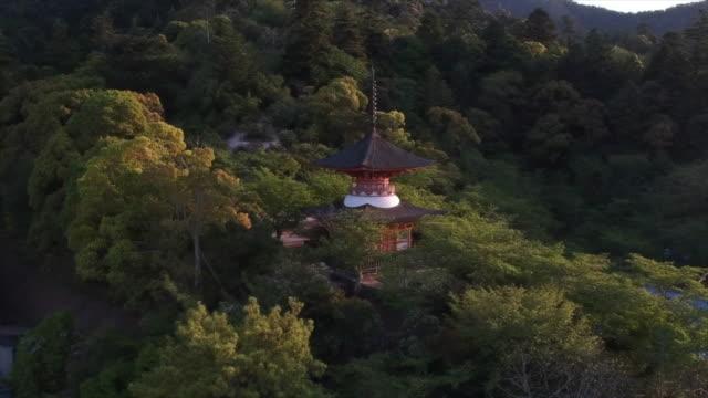 miyajima's pagoda (hiroshima region japan) by drone - shinto shrine stock videos & royalty-free footage