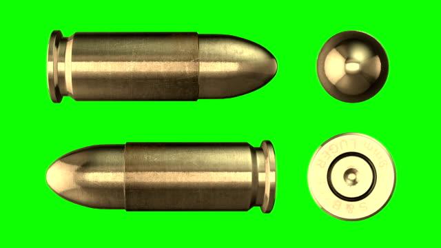 9 mm kugel zurück. luminanz-matte - pistolenschießen stock-videos und b-roll-filmmaterial