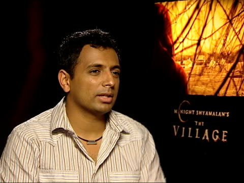mnight shyamalan interviewed sot talks about his name as a 'brand' being a good and bad situation / thinks of himself as an author / talks about... - woody allen stock videos & royalty-free footage