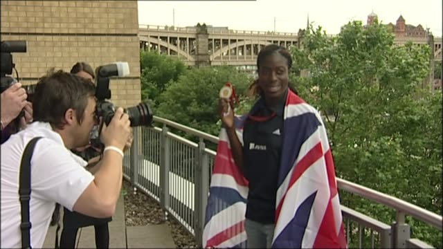 mo farah alleged to have missed two drugs tests before london olympic games lib / 2982008 various shots of christine ohuruogu posing with olympic... - olympic medal stock videos & royalty-free footage