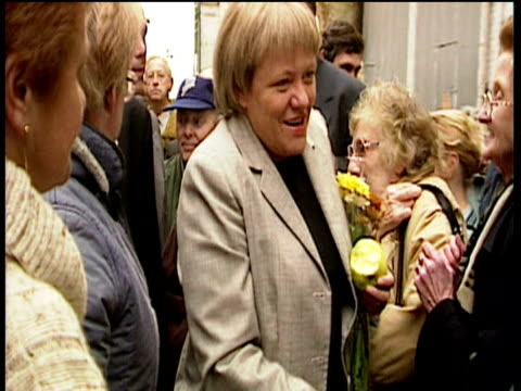 Mo Mowlam Secretary of State for Northern Ireland meets women in market on walkabout 1990's