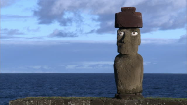 moai statue with pukao and eyes, easter island - polynesia stock videos & royalty-free footage